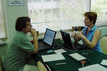THAILAND 2005: Sigrid I. Kvaal (left) is comparing teeth with dental records, for the victims of the tsunami in Thailand. Here she is cooperating with Sinnika Syrjelainen from Finland.